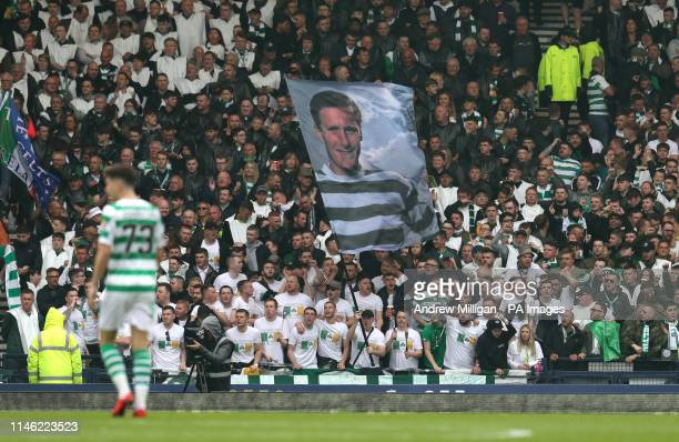 Celtic players hold a Billy McNeill flag in the stands during the William Hill Scottish Cup Final at Hampden Park Glasgow
