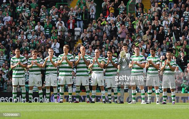 Celtic players hold a minute's applause prior to the Clydesdale Bank Premier League match between Celtic and Hearts to mark the 25th anniversary of...