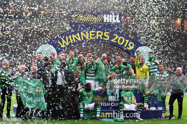 Celtic players pose with the Scottish Cup at the final whistle during the Scottish Cup Final between Heart of Midlothian FC and Celtic FC at Hampden...