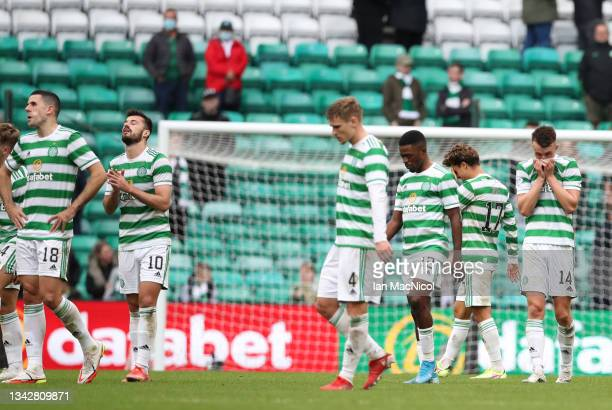 Celtic players react on the final whistle as the fans look on after a 1-1 draw after the Cinch Scottish Premiership match between Celtic FC and...