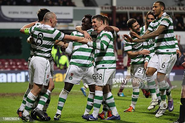 Celtic players surround Gary Hooper as he celebrates after scoring during the Scottish Clydesdale Bank Premier League match between Hearts and Celtic...