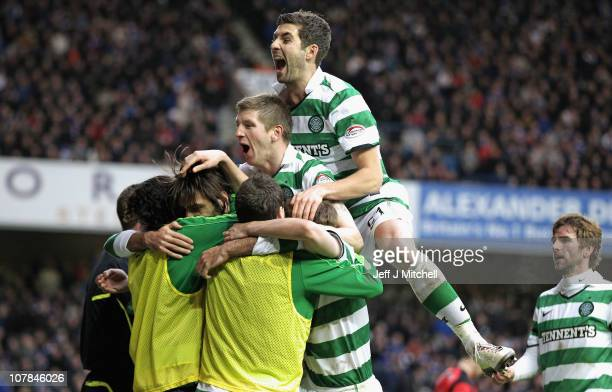 Celtic players surround Georgios Samaras after he scored his second goal during the Clydesdale Bank Premier League match between Rangers and Celtic...