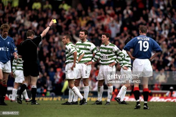 Celtic players watch as Referee Kenny Clark sends off Alan Thompson