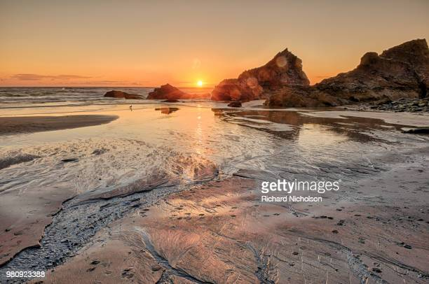 celtic sea and bedruthan steps at sunset, newquay, cornwall, uk - newquay stock pictures, royalty-free photos & images