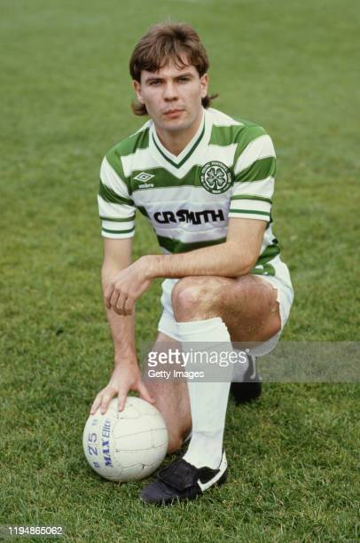 Celtic striker Brian McClair poses with a Max Elite Football in full Celtic Umbro kit and Nike boots in August 1983 in Glasgow United Kingdom