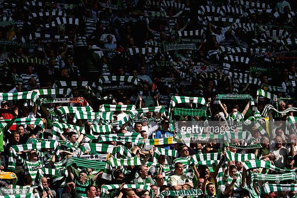 Celtic supporters hold up flags before the Clydesdale Bank Scottish Premier League match between Celtic and Rangers at Parkhead on April 27 2008 in...