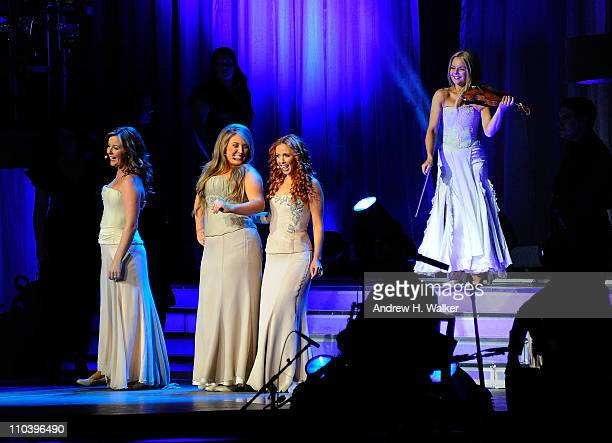 Celtic Woman members Lisa Kelly Chloe Agnew Lisa Lambe and Mairead Nesbitt perform at Radio City Music Hall on March 17 2011 in New York City