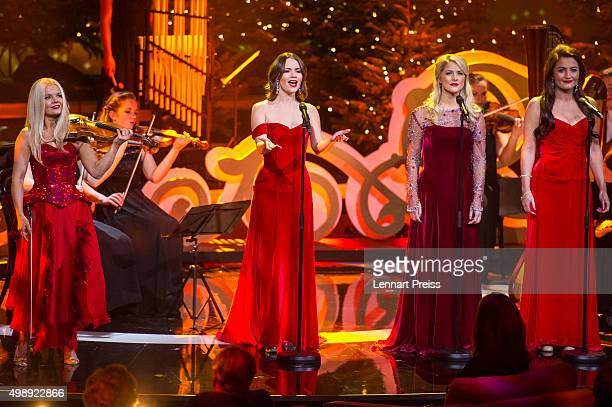 Celtic Woman perform during the 'Heiligabend mit Carmen Nebel' TV show at Bavaria Filmstudios on November 26 2015 in Munich Germany