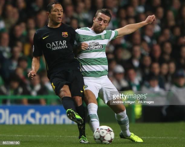 Celtic's Adam Mathews challenges Barcelona's Adriano
