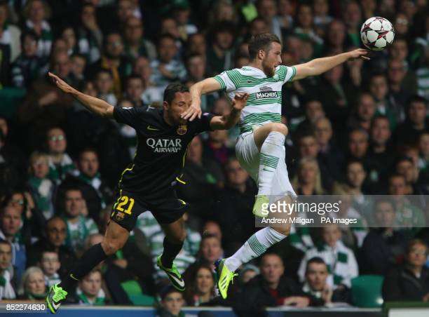 Celtic's Adam Mathews challenges Barcelona's Claro Adriano during the UEFA Champions League match at the Celtic Park Glasgow