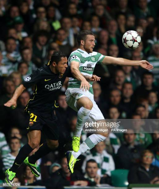 Celtic's Adam Matthews challenges Barcelona's Claro Adriano during the UEFA Champions League match at the Celtic Park Glasgow