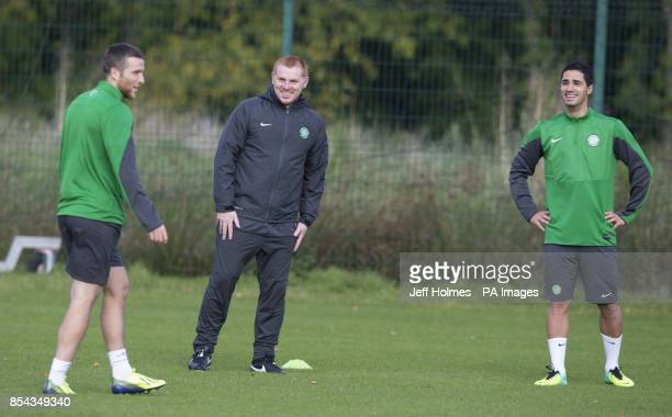 Celtic's Adam Matthews with manger Neil Lennon and Beram Kayal during a training session at Lennoxtown Glasgow