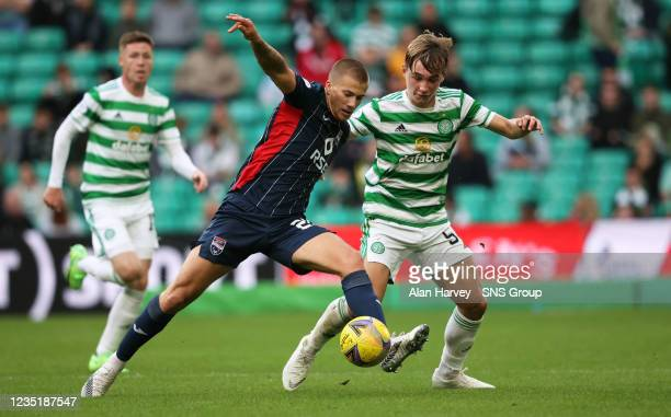 Celtic's Adam Montgomery and Harry Clarke in action during a cinch Premiership match between Celtic and Ross County at Celtic Park on September 11 in...