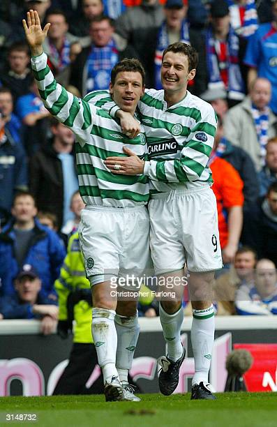 Celtic's Alan Thompson celebrates scoring with team mate Chris Sutton during the Scottish premier league match between Rangers and Celtic at Ibrox...
