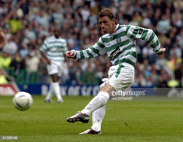 Celtic's Alan Thompson slams the ball home into Rangers net for the winning goal late in the game 29 August 2004 in the Scottish Premier League match...
