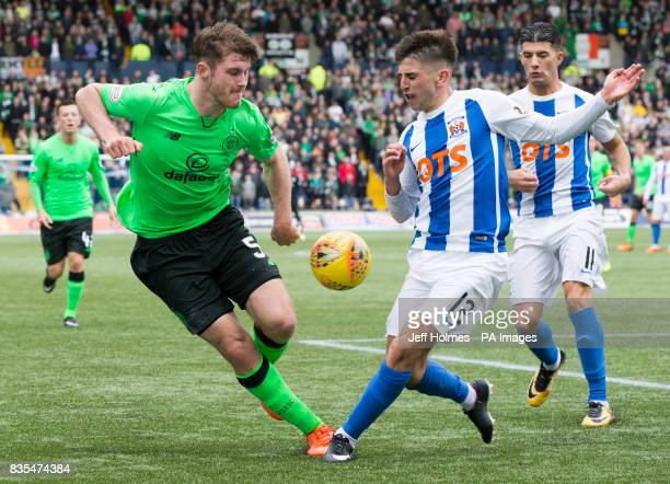 Celtic's Anthony Ralston and Kilmarnock's Greg Taylor battle for the ball during the Scottish Premiership match at Rugby Park Kilmarnock