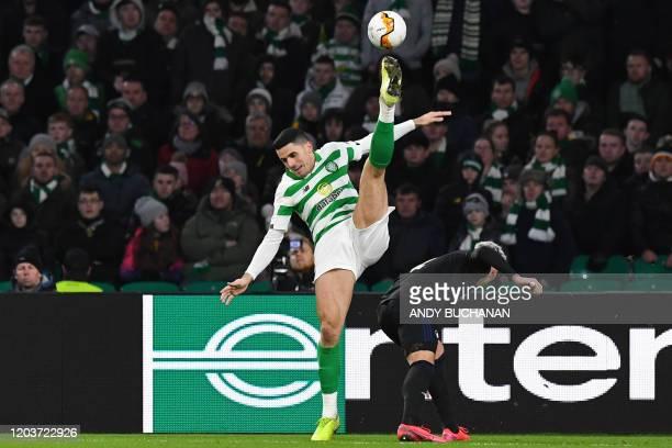Celtic's Australian midfielder Tom Rogic vies with FC Copenhagen's Uruguayan defender Guillermo Varela during the UEFA Europa League round of 32...