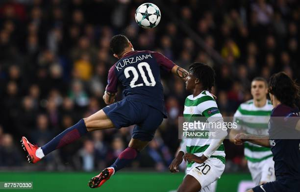 Celtic's Belgian defender Dedryck Boyata fights for the ball with Paris SaintGermain's French defender Layvin Kurzawa during the UEFA Champions...