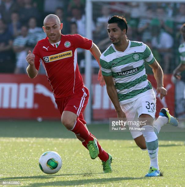 Celtic's Beram Kayal in action with Cliftonville's Barry Johnston during the first leg of the UEFA Champions League Second Round Qualifying at...