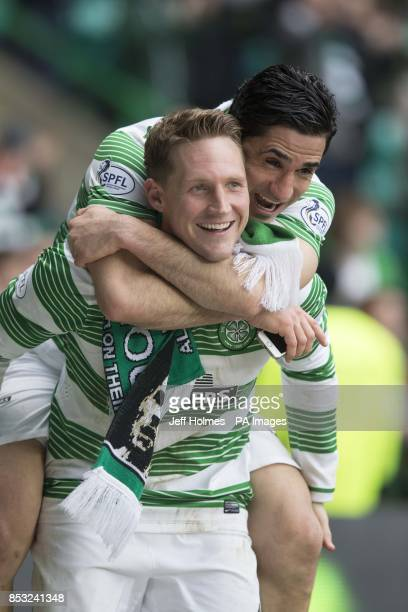 Celtic's Beram Kayal jumps on back of Kris Commons during the Scottish Premiership match at Celtic Park Glasgow