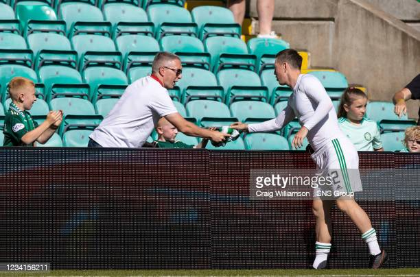 Celtic's Callum McGregor gives away his shirt at full time during a friendly match between Celtic and West Ham United at Celtic Park on July 24 in...