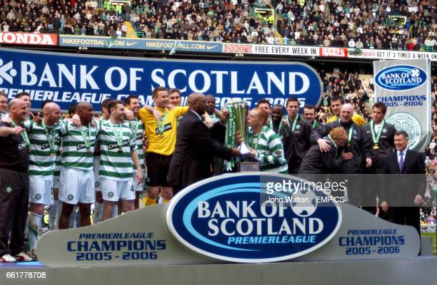 Celtic's captain Neil Lennon kisses the trophy as he prepares to lift it as they celebrate winning the league