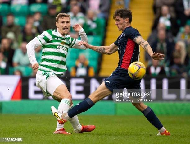 Celtic's Carl Starfelt in action with Ross Callachan of Ross County during a cinch Premiership match between Celtic and Ross County at Celtic Park on...