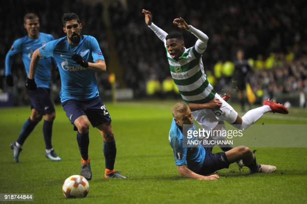 Celtic's Carly Musonda is tackled by Zenit St Petersburg's Russian defender Igor Smolnikov during the UEFA Europa League football match between...