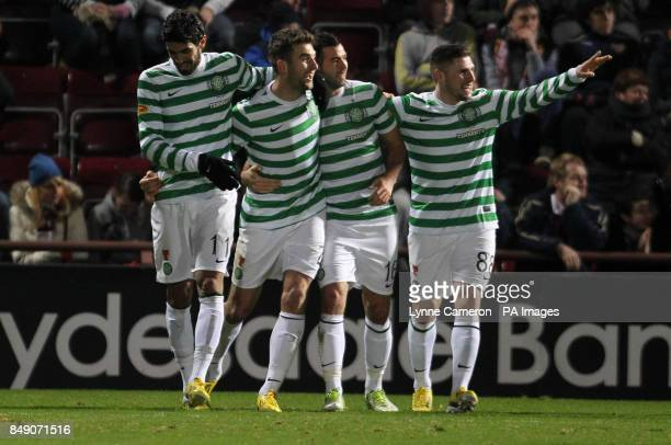 Celtic's Charlie Mulgrew and team mates celebrates after Hearts Ryan Stevenson scored an own goal during the Clydesdale Bank Scottish Premier League...