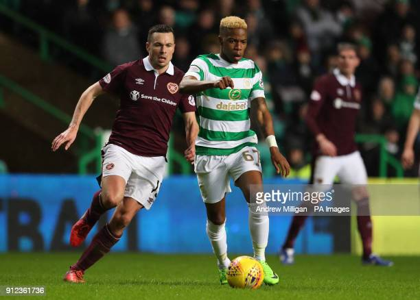 Celtic's Charly Musonda challenges Hearts' Don Cowie during the Scottish Premiership match at Celtic Park Glasgow
