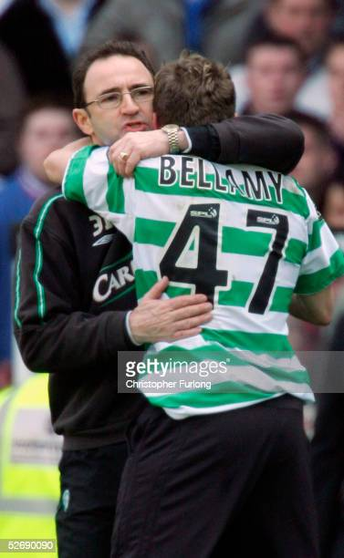 Celtic's Craig Bellamy celebrates beating Rangers with Celtic coach Martin O'Neill at the end of the Scottish Premier League match between Glasgow...