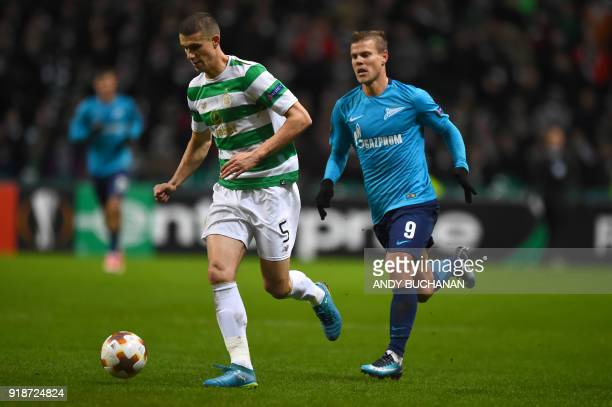 Celtic's Croatianborn Bosnian defender Jozo Simunovic vies with Zenit St Petersburg's Russian forward Aleksandr Kokorin during the UEFA Europa League...