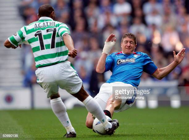 Celtic's Didier Agathe evades a tackle from Rangers' Gregory Vignal during Scottish Premier League match between Glasgow Rangers and Celtic at Ibrox...