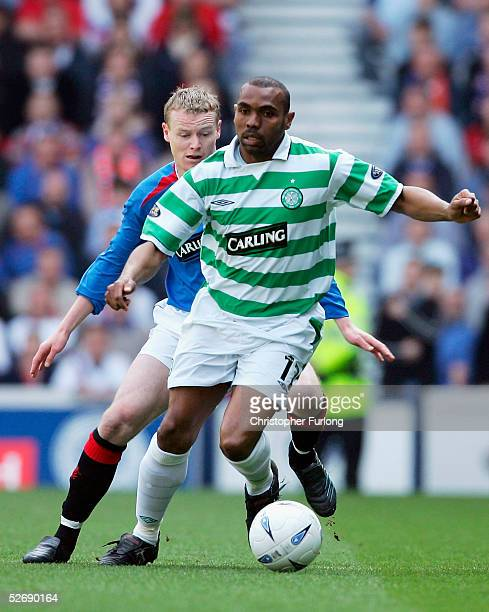 Celtic's Didier Agathe evades a tackle from Rangers' Michael Ball during Scottish Premier League match between Glasgow Rangers and Celtic at Ibrox...