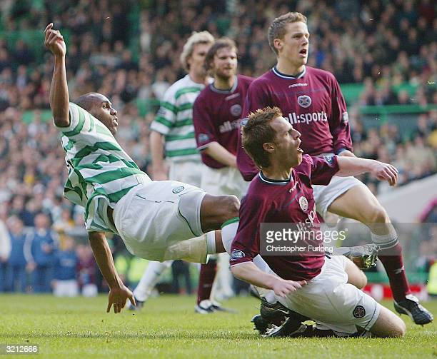 Celtic's Didier Agathe scores the equaliser in injury time during the Scottish Premier League match between Celtic and Hearts at Celtic Park on April...