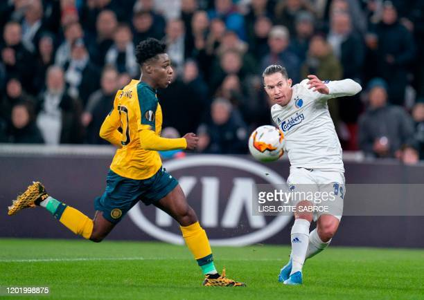Celtic's Dutch defender Jeremie Frimpong and FC Copenhagen's Costa Rican defender Bryan Oviedo vie for the ball during the Europa League last 32...