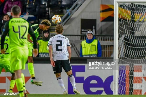 Celtic's English forward Scott Sinclair heads the ball to score 10 during the UEFA Europa League group B football match Rosenborg BK v Celtic FC on...