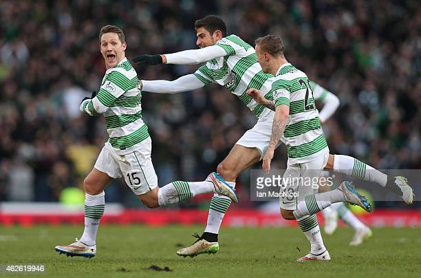 Celtic's English midfielder Kris Commons celebrates after he scores during the Scottish League Cup Semi-Final football match between Celtic and...