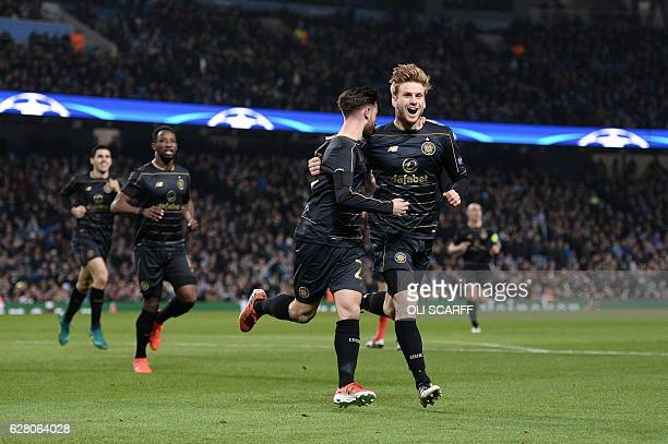 Celtic's English midfielder Patrick Roberts celebrates scoring his team's first goal with Celtic's Scottish midfielder Stuart Armstrong during the...