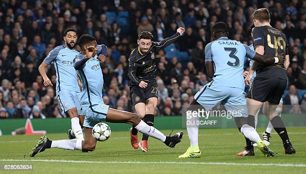 Celtic's English midfielder Patrick Roberts scores his team's first goal during the UEFA Champions League group C football match between Manchester...