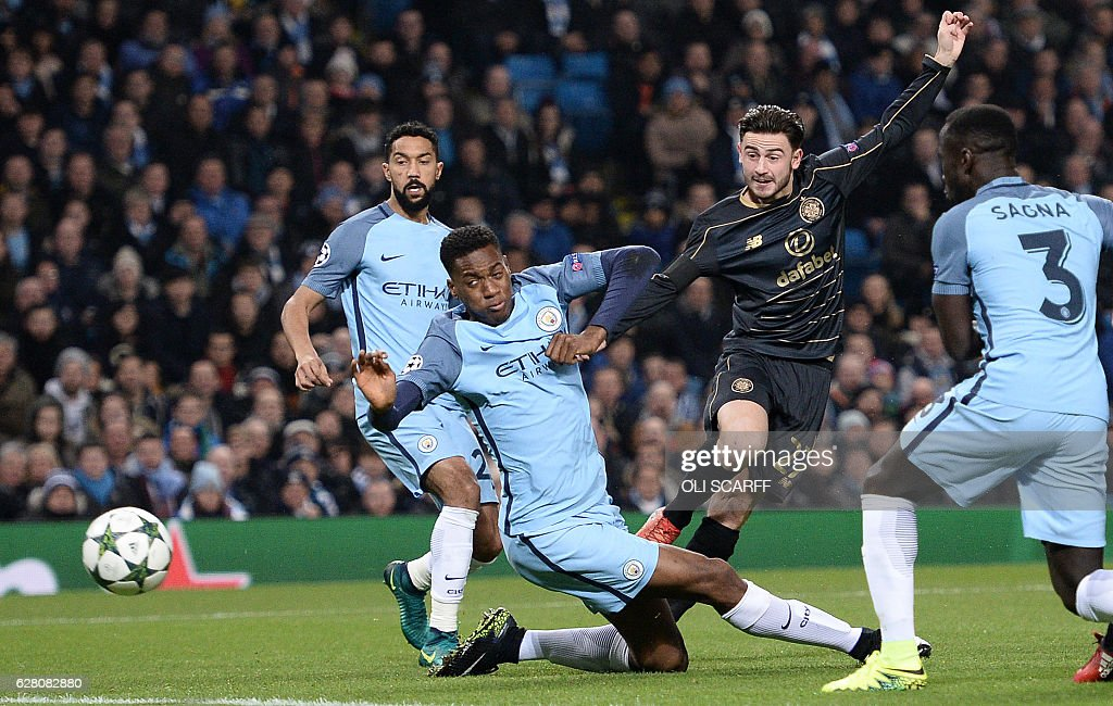 Celtic's English midfielder Patrick Roberts (R) shoots past Manchester City's English defender Oluwatosin Adarabioyo (C) to score his team's first goal during the UEFA Champions League group C football match between Manchester City and Celtic at the Etihad Stadium in Manchester, northern England, on December 6, 2016. The match ended in a draw at 1-1. / AFP / Oli SCARFF