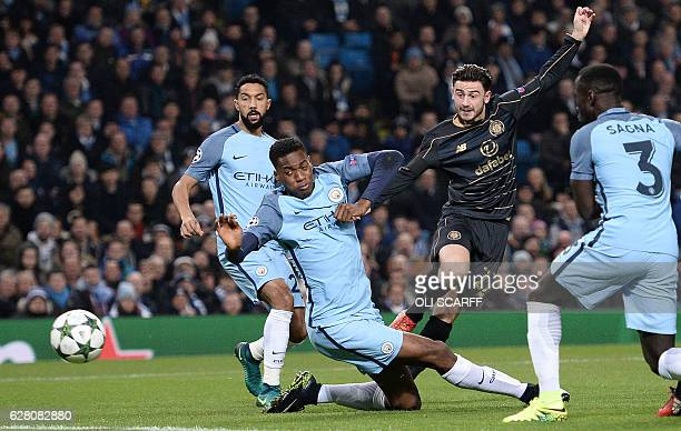Celtic's English midfielder Patrick Roberts shoots past Manchester City's English defender Oluwatosin Adarabioyo to score his team's first goal...
