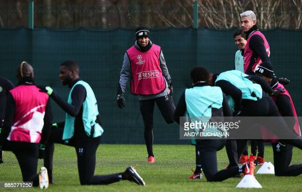 Celtic's English midfielder Scott Sinclair attends a training session with teammates at the Celtic Training Centre in Lennoxtown Scotland on December...