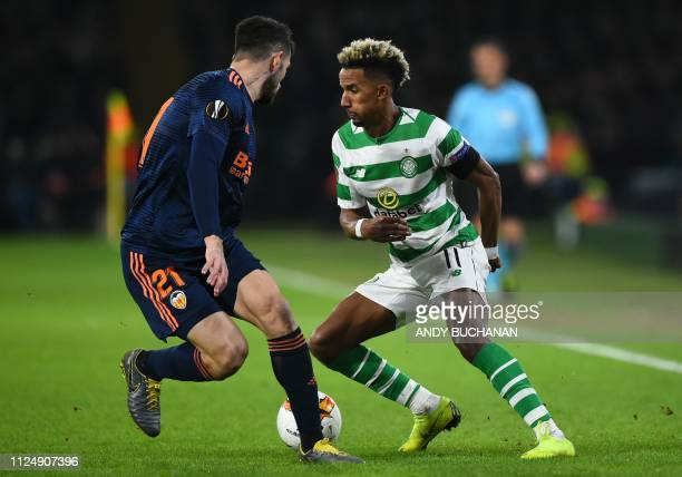 Celtic's English midfielder Scott Sinclair takes on Valencia's Italian defender Cristiano Piccini during the UEFA Europa League round of 32 first leg...