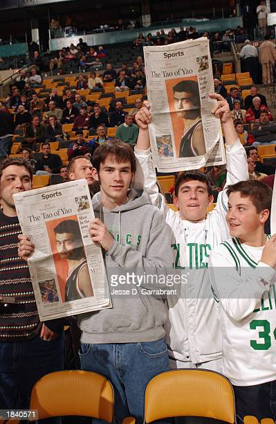 Celtics fans show their enthusiasm to see Yao Ming of the Houston Rockets as they hold a newspaper featuring Yao Ming on the cover of the sports...