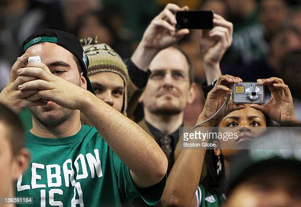 Celtics fans use various devices to record the team during pregame warmups The Boston Celtics hosted the Washington Wizards in a regular season NBA...