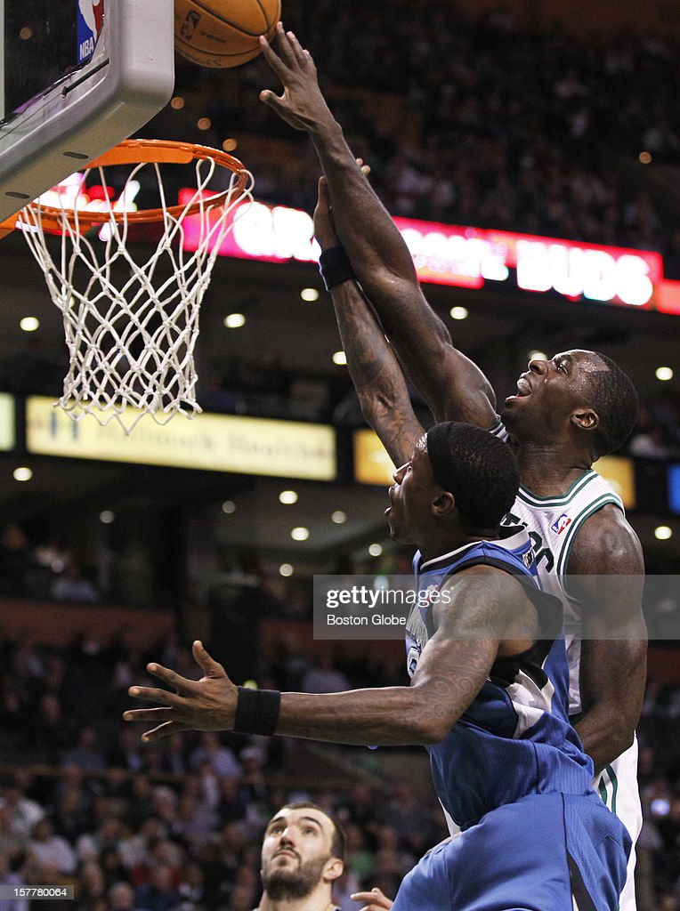 Celtics forward Brandon Bass (#30) blocks a shot attempt by Timberwolves forward Josh Howard (#5) in the third quarter as the Boston Celtics play the Minnesota Timberwolves during a regular season NBA game at the TD Garden in Boston, Mass. on Wednesday, Dec. 5, 2012.