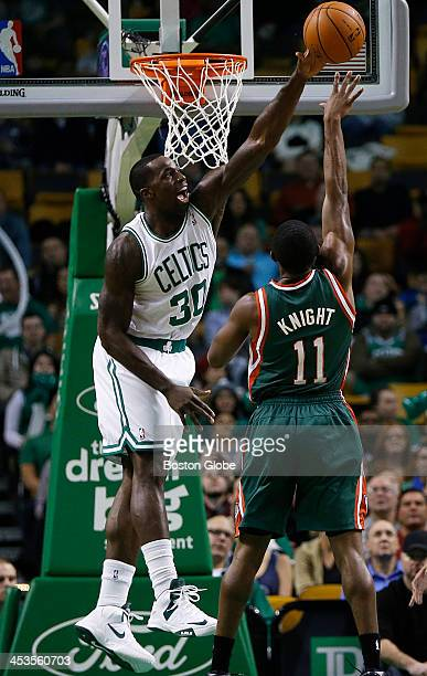 Celtics forward Brandon Bass rejected a jump shot by Bucks guard Brandon Knight in the first quarter The Boston Celtics played the Milwaukee Bucks at...