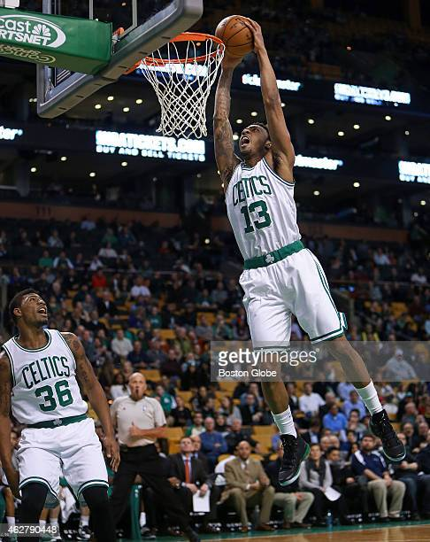 Celtics forward guard James Young slams home two first half points as teammate Marcus Smart looks on at left The Boston Celtics hosted the Denver...