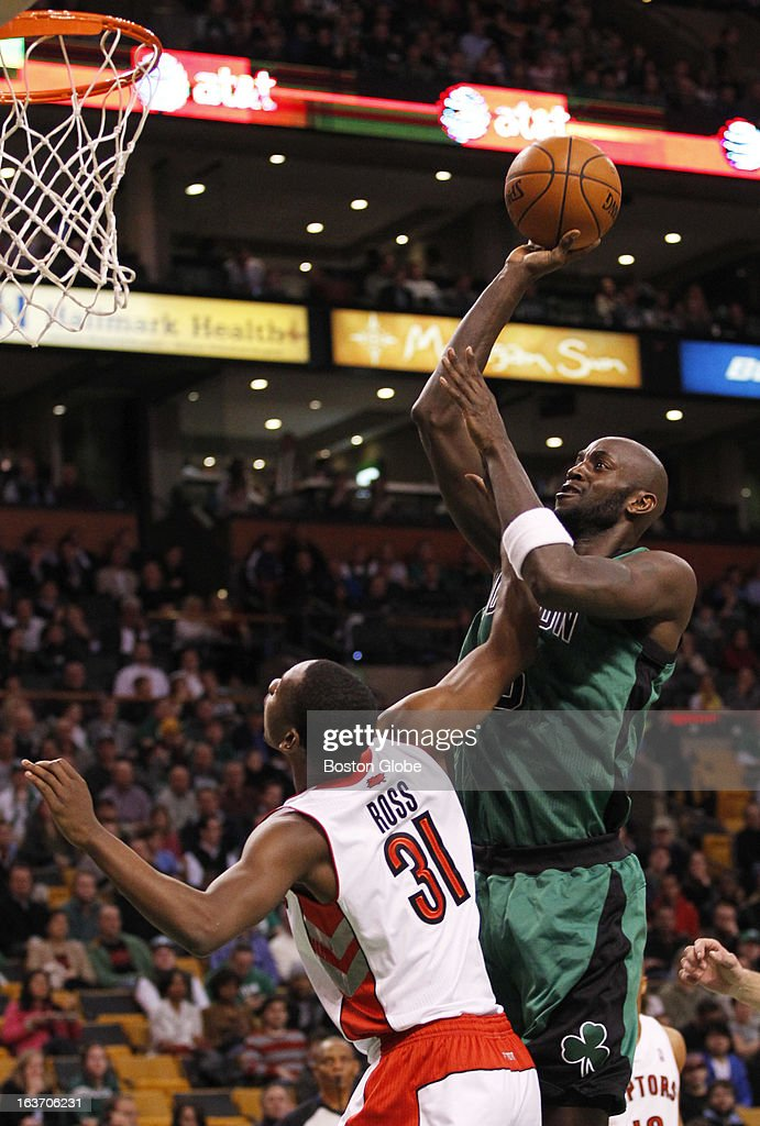 Celtics forward Kevin Garnett (#5) hits a bucket in the second quarter over Raptors forward Terrence Ross (#31) as the Boston Celtics hosted the Toronto Raptors at the TD Garden during a regular season NBA game in Boston, Mass. on Wednesday, March 13, 2013.